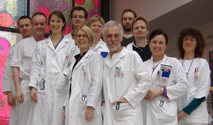 <b>Group photo at Norwegian PSC Research Center.</b><br>From right research nurse Mona Skevig, PhD student Kristin Kaasen Jørgensen, PhD student Johannes Roksund Hov, bioinformatics scientist Kristian Holm, professor Erik Schrumpf, head physician  Kirsten Muri Boberg, in charge of biobank: bioengineer Hege Dahlen Sollid, post doc Espen Melum, bioengineer Bente Woldseth, professor Lars Aabakken and group leader Tom Hemming Karlsen. Bioengineer Liv Wenche Thorbjørnsen and the researchers Trine Folseraas, Kim Andresen, Bjarte Fosby, Sigrid Næss and Alexey Shiryaev are also connected with the group.